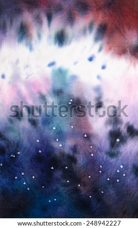Cosmos filled with stars. Abstract tie dyed fabric background - stock photo