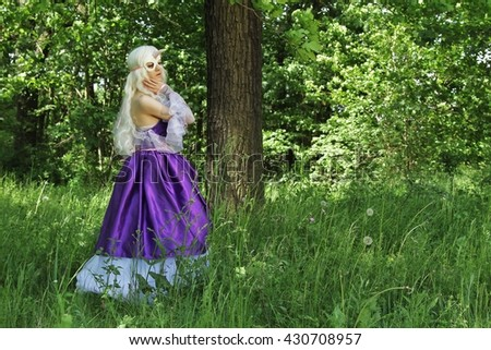 Cosplay scene / unicorn (Amalthea is hiding in the forest) - stock photo