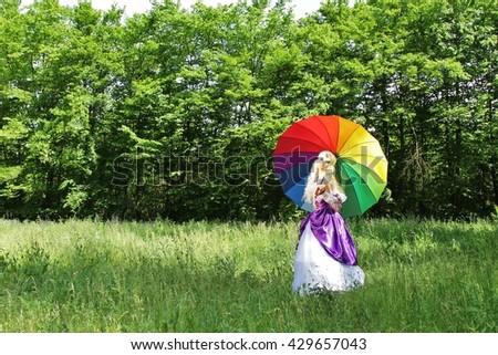 Cosplay scene / unicorn (Amalthea with colorful parasol) - stock photo