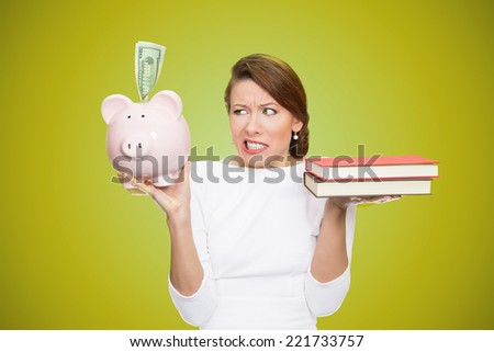 Cost of college education. Portrait stressed woman balancing piggy bank in one hand and books in another. Student having trouble paying for academic university degree tuition concept. Face expressions - stock photo