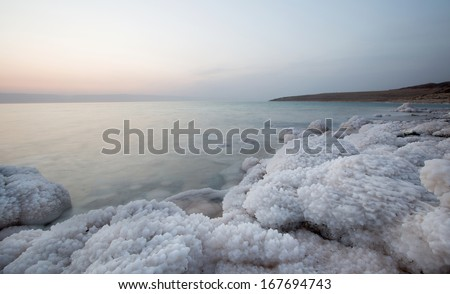 Cost of Dead Sea with amazing salt forms, located in Jordan part - stock photo
