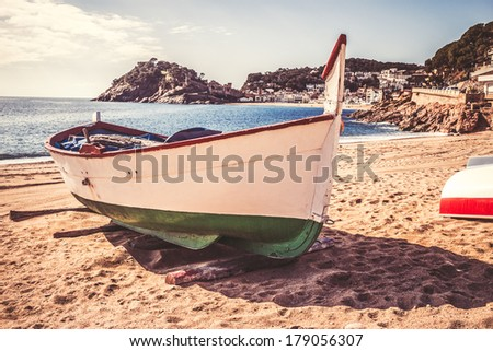Costa Brava - Tossa de Mar beach in a sunny day with vintage colors - stock photo