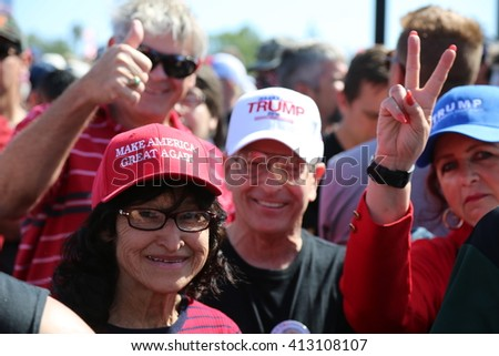 Costa Mesa, CA - April 28, 2016: Estimated 31,000 supporters of republican presidential candidate Donald Trump, cheer and wait patiently in line for to hear his speech at a rally at the Costa Mesa CA. - stock photo