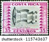 """COSTA RICA - CIRCA 1954: A stamp printed in Costa Rica from the """"National Industries"""" issue shows textiles industry, circa 1954. - stock photo"""