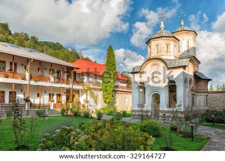 COSTESTI, ROMANIA - CIRCA SEPTEMBER , 2015: Arnota Monastery was erected by prince Matei Basarab between 1634-1636. It is said that Matei decided to build this monastery when he was chased by the Turks. - stock photo