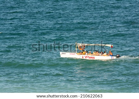 COSTINESTI, ROMANIA - JULY 28, 2014: People Boat Trip On The Black Sea Beach In Costinesti Holiday Resort. - stock photo