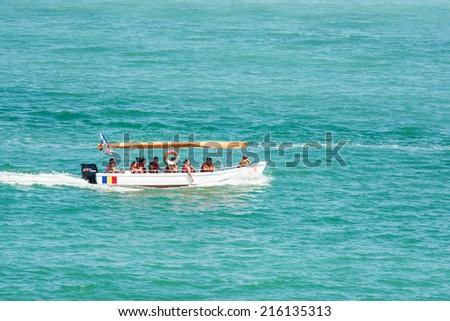 COSTINESTI, ROMANIA - JULY 30, 2014: People Boat Trip On The Black Sea Beach In Costinesti Holiday Resort. - stock photo