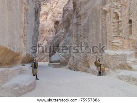 Costumed sentries guard passage to spectacular Petra, Jordan - stock photo