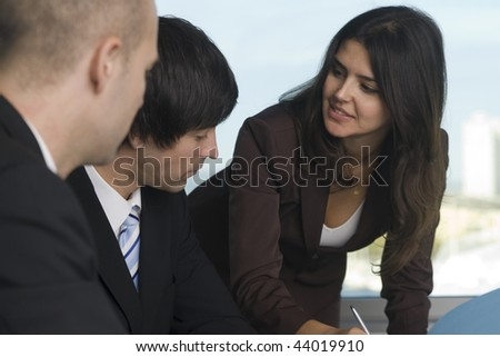 Costumer talk at a nice table, two businessman and one businesswoman - stock photo