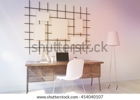 Cosy home office with laptop, stylish furniture and posters on wall. Concept of study. 3D render. Mock up. Toned image - stock photo