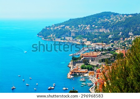 Cote d'Azur France.  View of luxury resort and bay of French riviera - Villefranche-sur-Mer is situated between Nice city and Monaco. Mediterranean Sea - stock photo