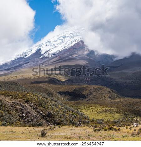 Cotopaxi Volcano top behind the clouds of the Cotopaxi National Park, Ecuador - stock photo