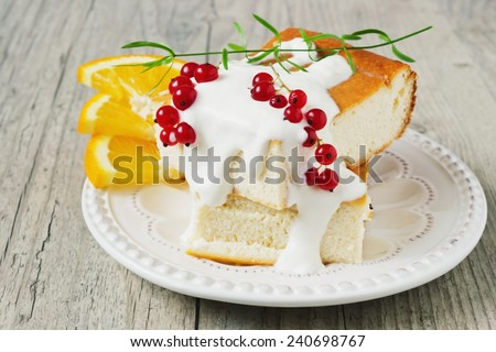 cottage cheese casserole, fresh fruit and berries on a plate on a wooden background. health or diet concept - stock photo