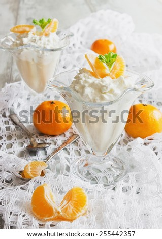 cottage cheese dessert with orange slices in the beautiful ice-cream bowls on the table. health and diet food - stock photo