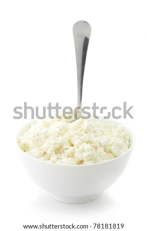 Cottage cheese in white bowl with spoon isolated on white background. - stock photo