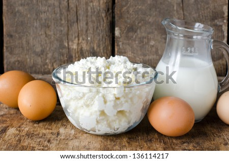 Cottage cheese, milk and eggs. selective focus - stock photo