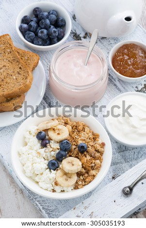 cottage cheese, muesli and fresh fruit for healthy breakfast, top view - stock photo