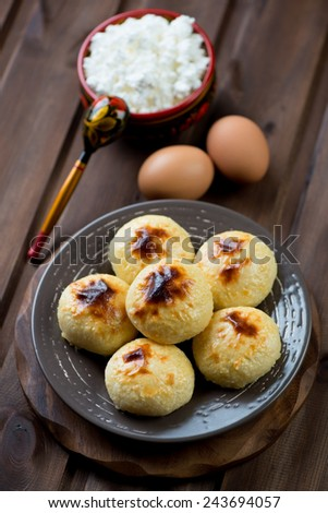 Cottage cheese pancakes and various ingredients, studio shot - stock photo