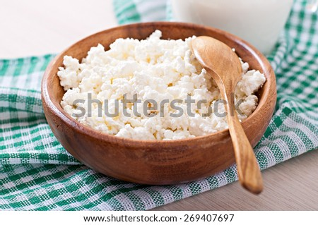 Cottage cheese with apples for breakfast in wooden bowl close up - stock photo