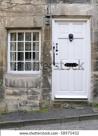 Cottage Front Door and Window - stock photo