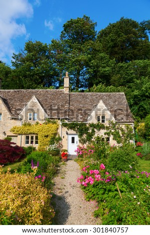 cottage in the picturesque village Bibury, Gloucestershire, England - stock photo