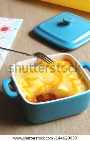 Cottage pie in a blue casserole - stock photo