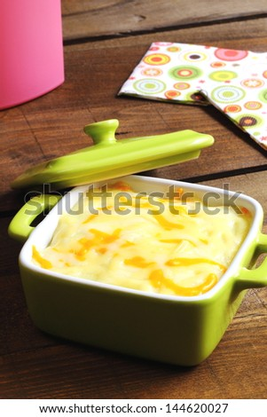 Cottage pie in a green casserole - stock photo