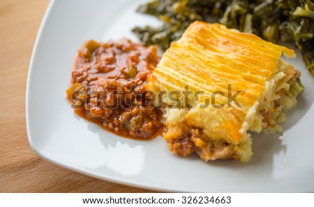 Cottage Pie with minced meat and Turnip Greens - stock photo