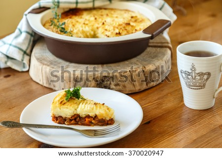 Cottage Pie with minced meat on a plate - stock photo