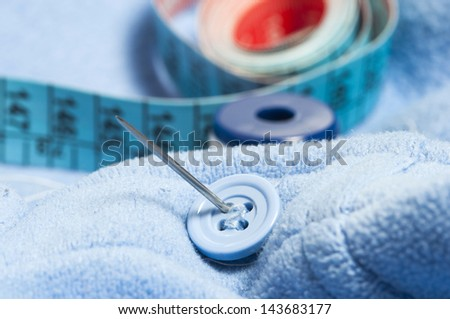 cotton button and meter detail - stock photo