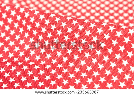 cotton fabric for  with stars on a red background - stock photo