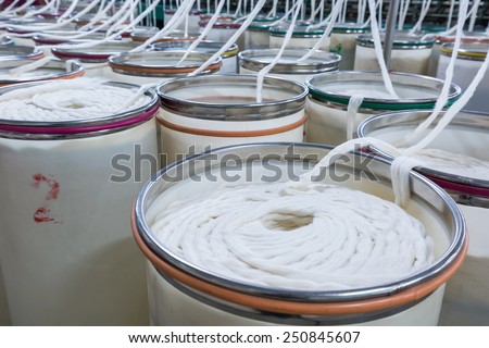 cotton group closeup in spinning production line factory - stock photo