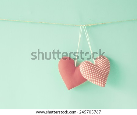 Cotton hearts over mint  - stock photo