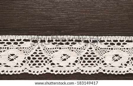 cotton lace on the wooden table - stock photo