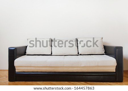 couch in white room - stock photo