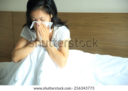 cough woman sneeze nose on bed  - stock photo