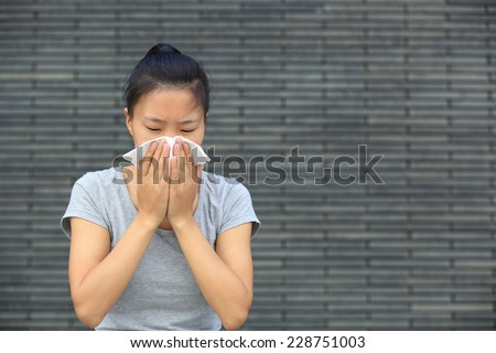 cough woman sneeze nose outdoor - stock photo