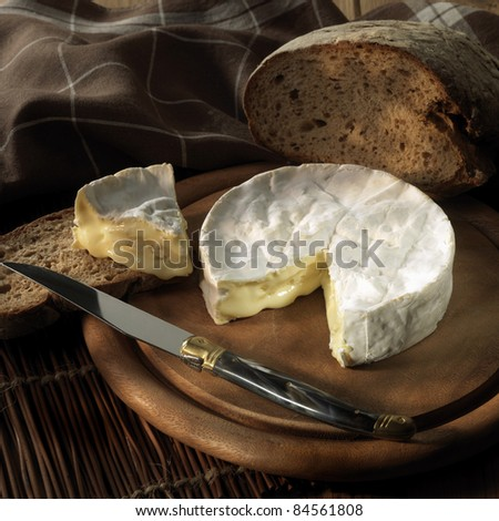 Coulommiers and bread - stock photo