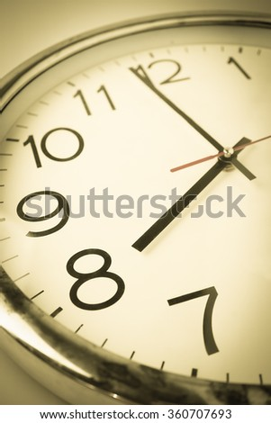countdown to 8 o'clock with vintage color style clock - stock photo