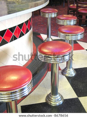 Counter and barstools of vintage roadside diner - stock photo