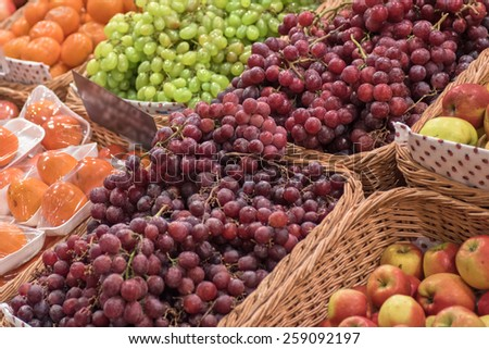 Counter with ripe grapes in supermarket  - stock photo