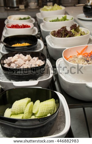 Counter with the vegetables prepared for salads - stock photo