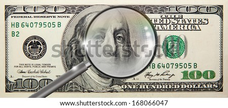 counterfeit coin magnifying glass isolated  - stock photo