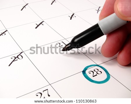 Counting down the days with a calendar - stock photo