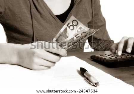 Counting the costs, can either be used for future growth or losses - stock photo
