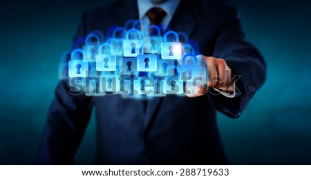 Countless closed lock icons combine to shape a virtual cloud. Torso of a business man in dark blue suit is reaching forward to touch the cloud with his index finger. Business metaphor for IT security. - stock photo