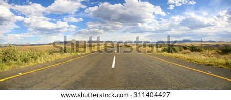 Country Highway on The Famous Garden road in South Africa with mountains and fields. - stock photo