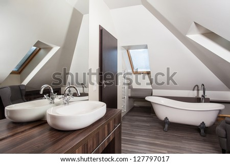 Country home - interior of a vintage attic bathroom - stock photo