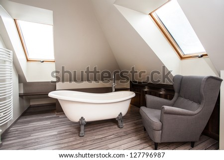 Country home - interior of vintage bathroom with armchair - stock photo
