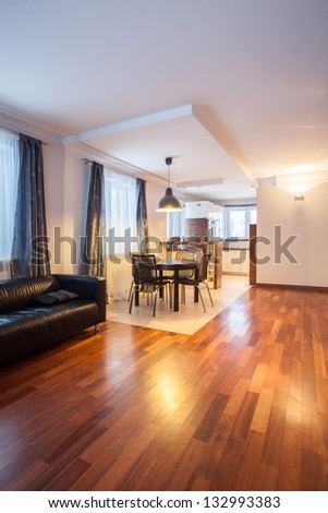 Country home - sofa and table in dining room - stock photo